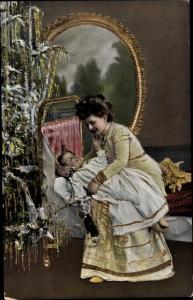 Ak Frohe Weihnachten, Mutter mit Kind vor dem Tannenbaum