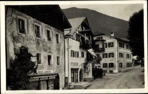 Ak St Wolfgang im Salzkammergut in Oberösterreich, Dorfpartie, Café, Geschäft