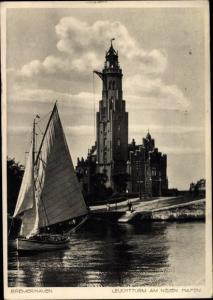Ak Bremerhaven, Leuchtturm am neuen Hafen, Segelboot