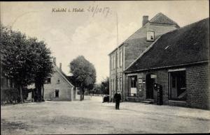 Ak Kaköhl in Holstein, Straßenpartie, Geschäftshaus