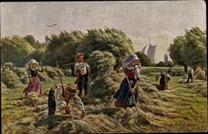Künstler Ak Henseler, E., Heuernte in der Niederung, Bauern auf dem Feld