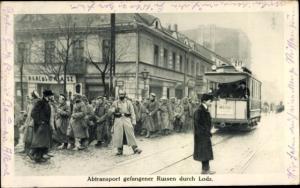 Ak Lodz Lodsch Litzmannstadt Polen, Abtransport gefangener Russen, Straßenbahn Linie 10
