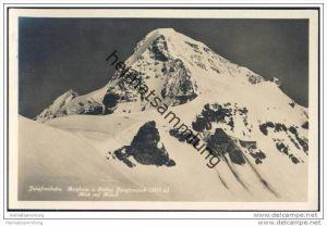 Jungfraubahn - Berghaus und Station Jungfraujoch - Blick auf Mönch - Foto-AK
