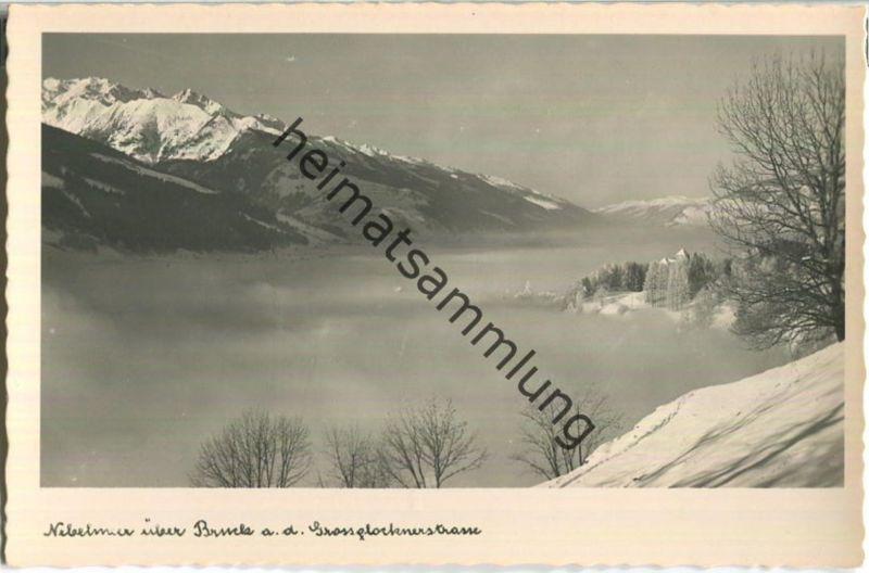 Nebelmeer über Bruck an der Grossglocknerstrasse - Foto-Ansichtskarte - Verlag Kaufhaus Peter Lederer Bruck