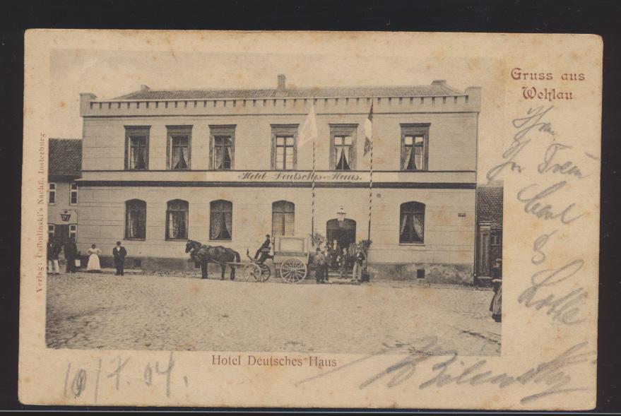 Ansichtskarte Wehlau Hotel Deutsches Haus Pferdekutsche Passanten Ostpreußen 0