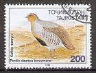 Briefmarke Tadschikistan Mi.Nr. 81 o Bedrohte Vogelarten in Tadschikistan1996 Motiv: Tienschan-Bartrebhuhn (Perdix barbata turcomana) (#10036)