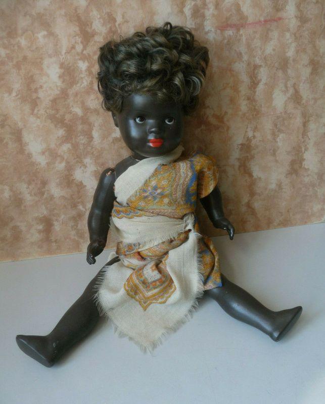 Kleine farbige schwarze Puppe Schlafaugen