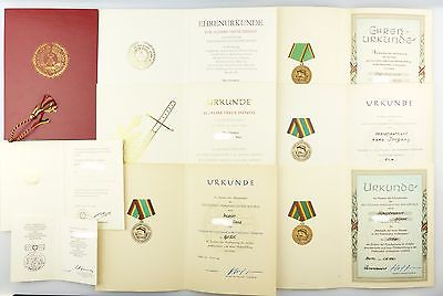 #e6995 Konvolut DDR NVA Urkunden + Mappe ab 50er Jahre z.B. treue Dienste Gold