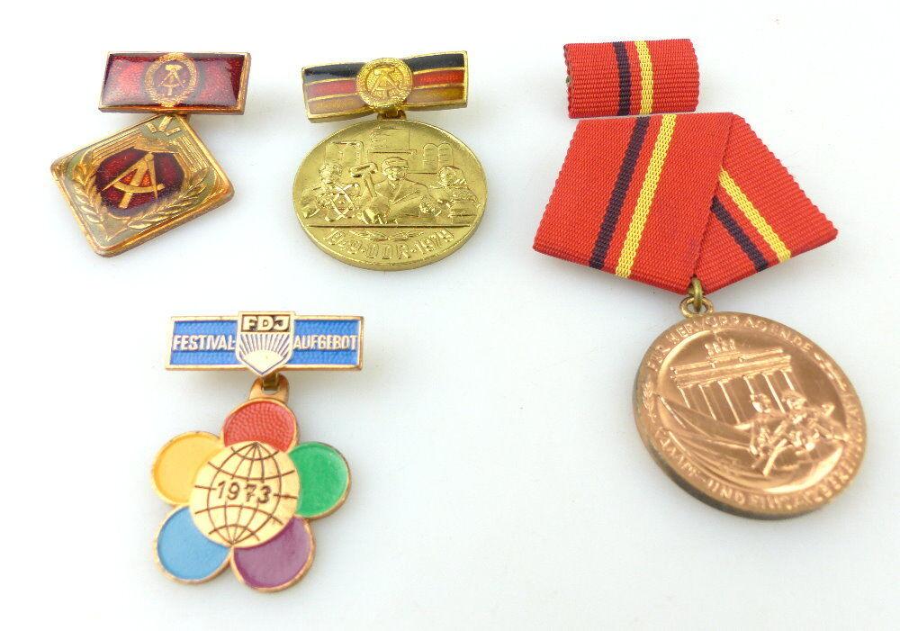 Konvolut 4 Abzeichen: Für hervorragende Kampf- und Einsatzbereitschaft... e1662