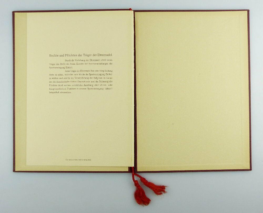 #e2979 Nachlass: Ehrenurkunde mit Ehrennadel BSG Einheit Rathenow Nr.313, 1956 1