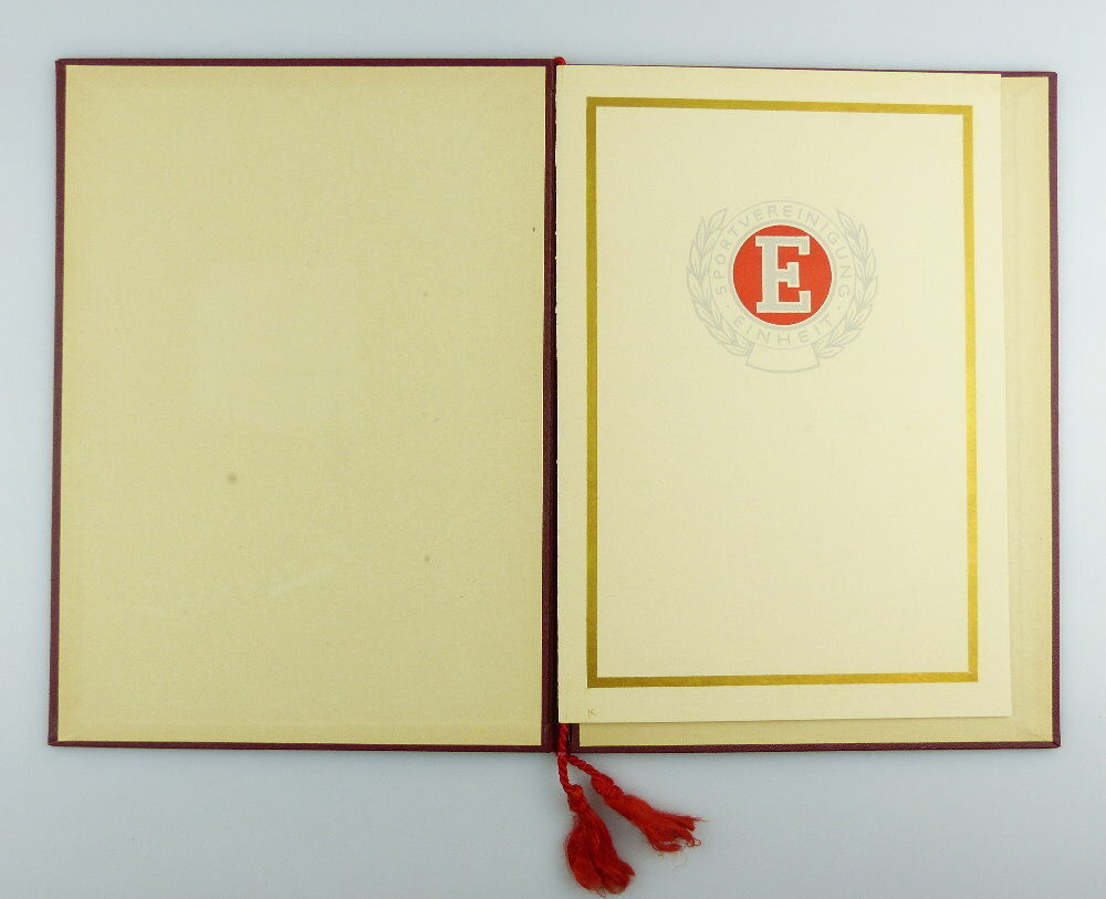 #e2979 Nachlass: Ehrenurkunde mit Ehrennadel BSG Einheit Rathenow Nr.313, 1956 0