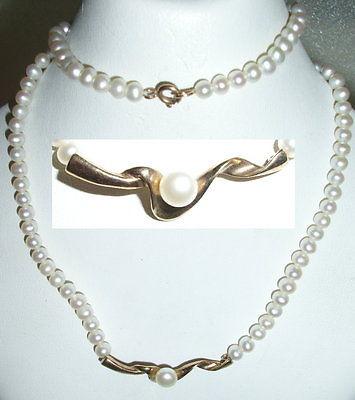 Collier mit kleinen Perlen und Anhänger aus 333er Gold mit Perle