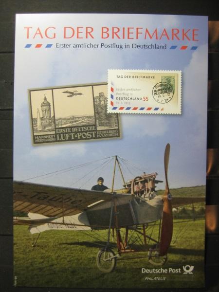 Gedenkblatt  Erinnerungsblatt der Deutsche Post: Tag der Briefmarke, 1. amtl. Postflug