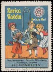 Kinder tanzen um Norica Nadel