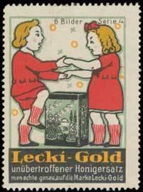 Kinder tanzen um Honig-Ersatz Lecki-Gold