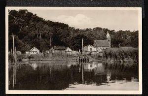 Schwarzort.Dorf und Kirche.