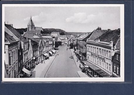 AK Mölln i. Lbg. Haupttsraße mit Kirche 1950