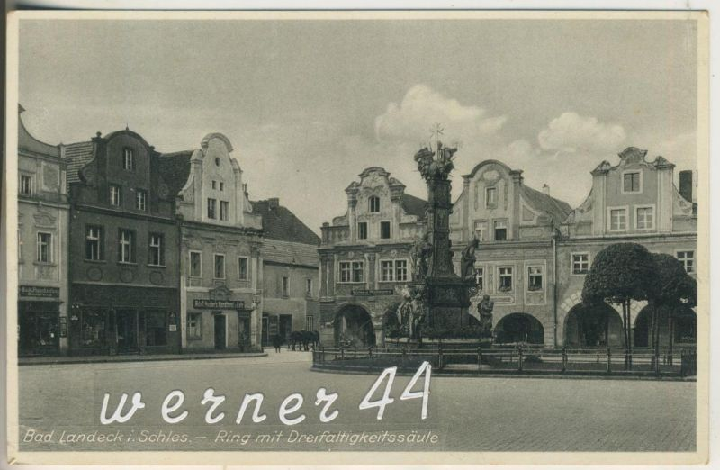 Bad Landeck v.1934 Ring mit Dreifaltigkeitssäule,Adolf Heider`s Konditorei & Cafe,Wollwarengeschäft,Buch(12605)