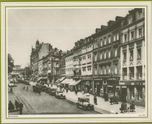 Saarbrücken v. 1925  Reichsstrasse mit Apotheke,Geschäfte, Cafe,Gasthof  (57504)