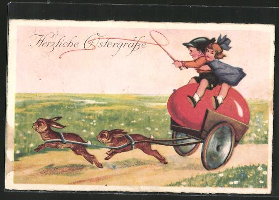 AK Herzliche Ostergrüsse, Hasen ziehen eine Kutsche mit einem Ei und zwei Kindern 0