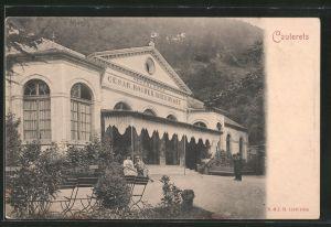 AK Cauterets, la facade principale des thermes, la terrasse, un homme et une femme sur un banc