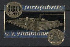 Präge-Reklamemarke 100 Jahre Tuchfabrik Thalmann, Logo und Fabrikansicht