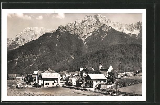 AK Waidring, Ortsansicht mit Steinbergen