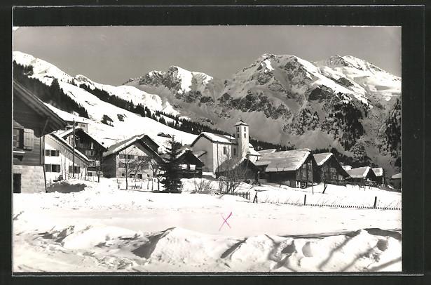 AK Molare, Ortsansicht mit Kirche im Winter