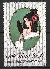 Reklamemarke AOK Teint-Seife, hübsches Mädchen betrachtet sich im Handspiegel