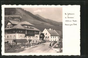 AK St. Johann a. Tauern, Strassenpartie am Gasthaus zur Post