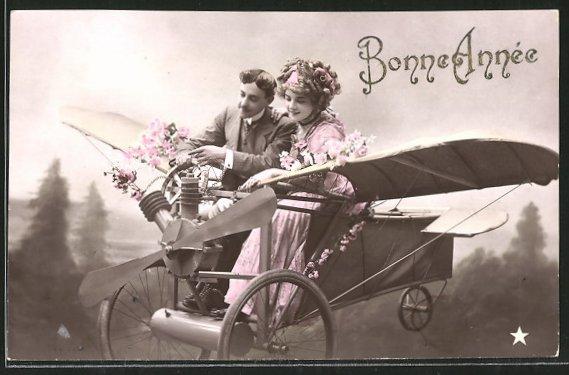 Fotomontage-AK Bonne Année, Liebespaar in fantastischem Flugzeug