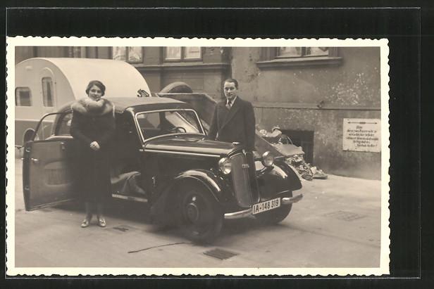 Foto-AK Paar mit DKW und Wohnwagen