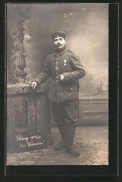 Foto-AK Soldat von Rgt. 179 mit Orden und EK II