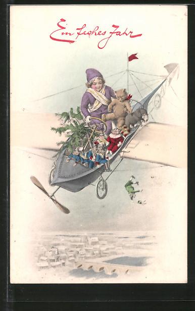 AK Ein frohes Jahr, Knabe mit Spielzeug in Flugzeug