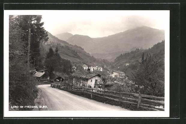 AK Lend im Pinzgau, Blick von einer Strasse auf den Ort