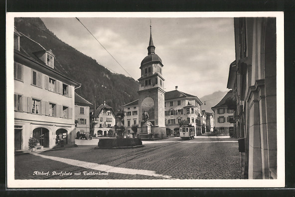 AK Altdorf, Strassenbahn am Dorfplatz mit Telldenkmal