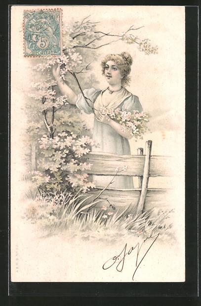 AK Junge Frau pflückt blühende Zweige von einem Baum