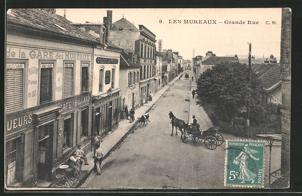 AK Les Mureaux, Grande rue mit Geschäften, Pferdekutsche