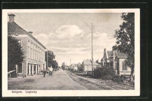 AK Bergum, Strassenpartie im Lageweg, Radfahrer