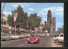 AK Berlin-Charlottenburg, Porsche 356 auf dem Kurfürstendamm, Blick zur Gedächtniskirche
