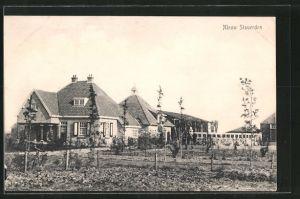 AK Nieuw Staverden, Ortspartie mit Häuserblick