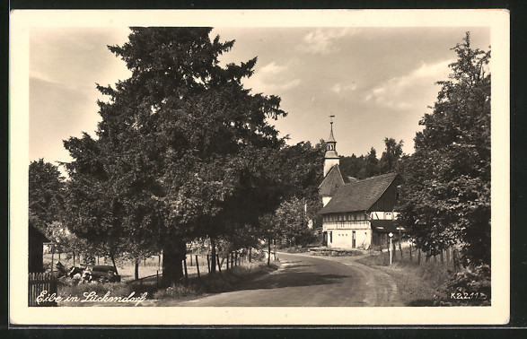 AK Lückendorf, Strassenpartie an der Kirche mit Eibe 0