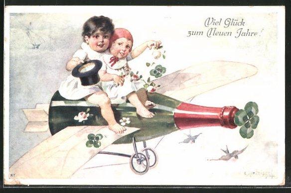 Künstler-AK E. Reckziegel: Kleines Paar auf einer Sektflasche mit Tragflächen