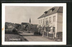 AK Eberschwang, Strassenpartie mit Blick zur Kirche
