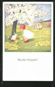 Künstler-AK Pauli Ebner: Kinder suchen auf der Blumenwiese Ostereier