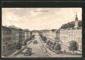 AK Uttendorf, Strassenpartie mit Kirchturm