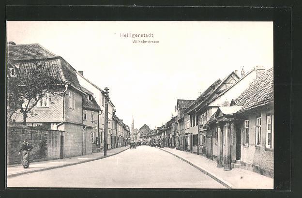 AK Heiligenstadt, Blick in die Wilhelmstrasse mit Kirche am Ende
