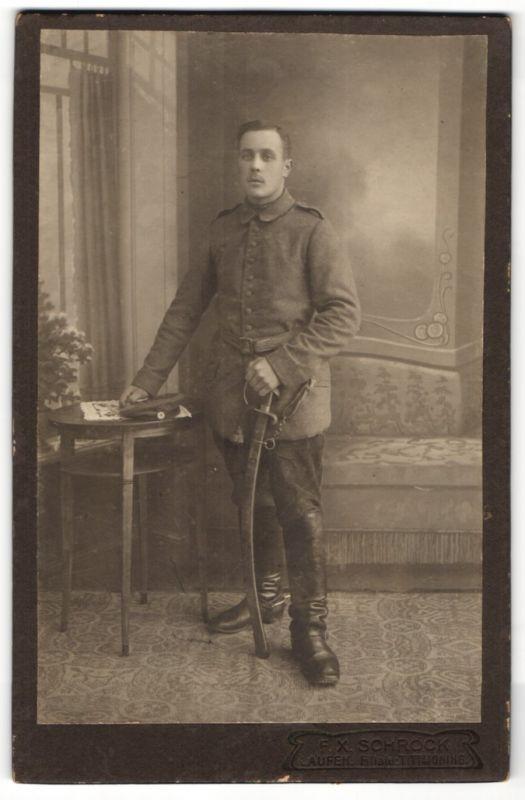 Fotografie F. X. Schröck, Laufen, Portrait Soldat in Feldgrau mit Säbel