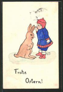 Künstler-AK Handgemalt: Frohe Ostern, Kind flüstert dem Osterhasen ins Ohr