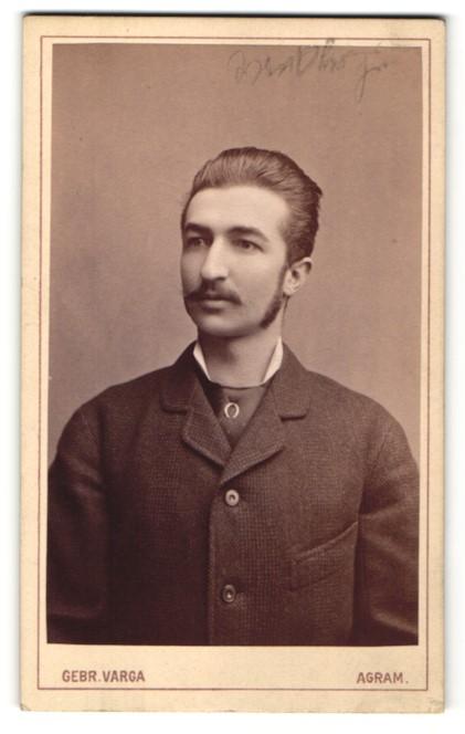 Fotografie Gebr. Varga, Agram, Portrait junger Mann mit Oberlippenbart und Koteletten